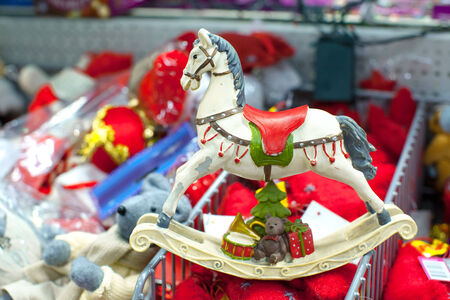 Christmas colorful toy horse for the fur in a supermarket photo