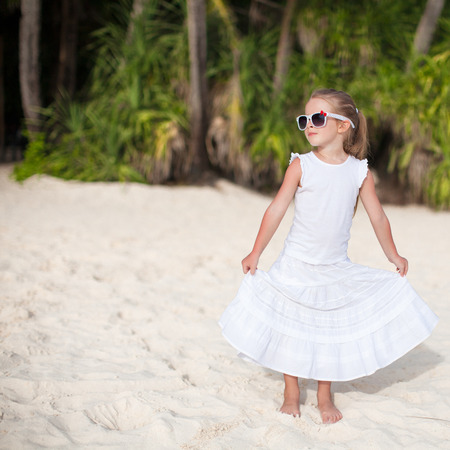 Adorable little girl on tropical beach vacation in Phillipines photo