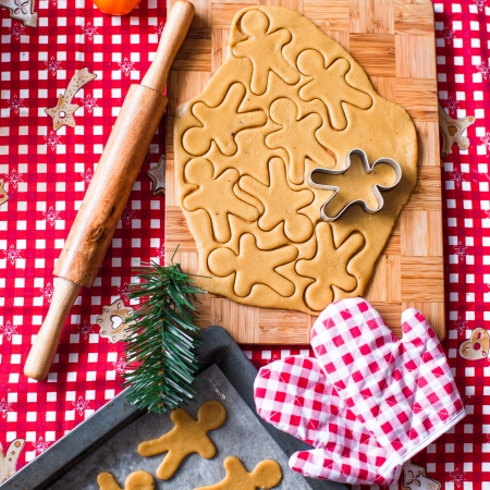 Cutting the gingerbread cookie dough for Christmas and New Year photo