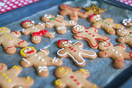 Raw gingerbread men on a baking photo