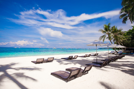 Beach wooden chairs for vacations and relax on tropical white sand plage Stock Photo