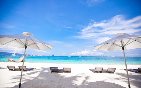 White umbrella and chairs on white beach and beautiful sea photo