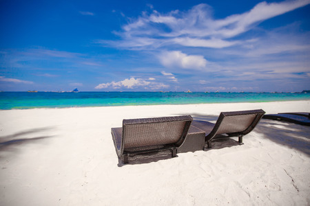 plage: Beach Chairs on beautiful island in white sand plage Stock Photo