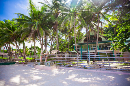 Abandoned and deserted hotel in the jungle on white beach photo