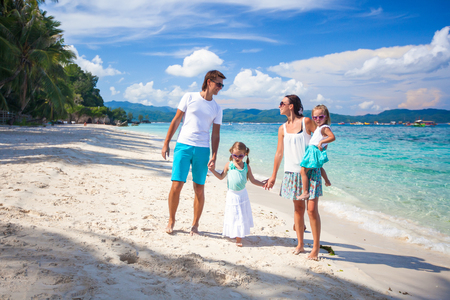 Young beautiful family with two kids on tropical vacation photo