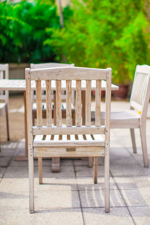 Outdoor cafe with white table and chairs near pool Stock Photo