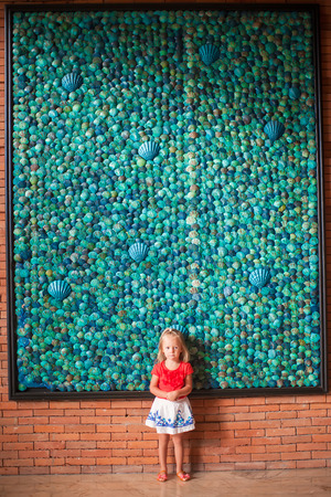 Adorable little girl in a big luxury hotel photo