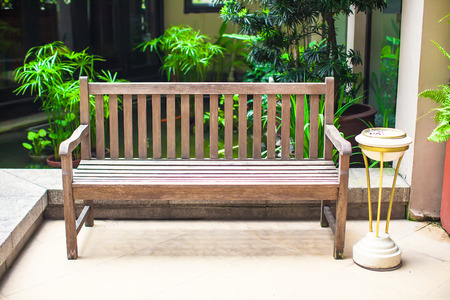 Wooden bench in the hotel photo