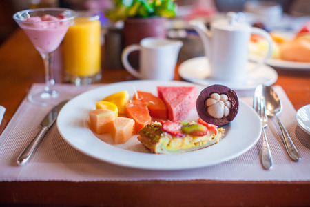 philippino: Philippino healthy breakfast with juicy fruits and black coffee Stock Photo
