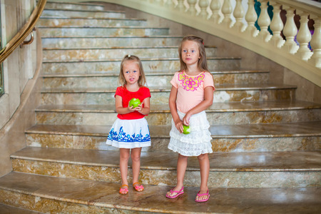 Adorable little girls in a big luxury hotel photo