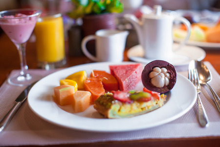 philippino: Philippino healthy breakfast with fruits,black coffee and juice Stock Photo