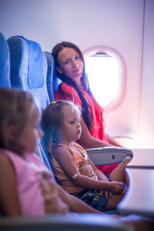 Young family in the airplane photo