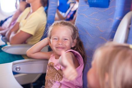 Little happy girl in the airplane photo