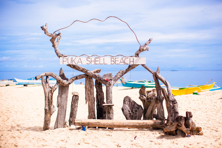 Title Puka beach on background blue sky in Boracay island photo