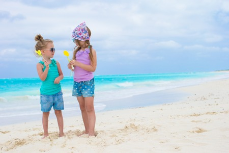 Little adorable girls with eggs on tropical beach Stock Photo - 27824587