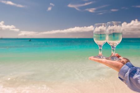 Two clean glasses on background of turquoisr sea photo