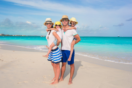 Young beautiful family with two kids on vacation photo
