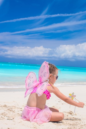 beach butterfly: Sweet girl with butterfly wings on the beach.