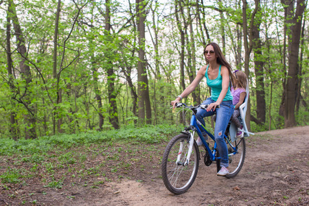 cycleway: Mother and daughter cycling bicycle at the park Stock Photo