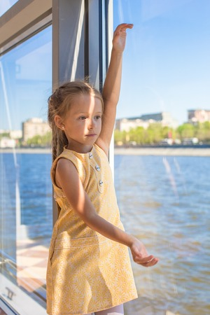 Little adorable girl relaxing on a luxury yacht photo