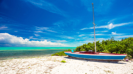 Old boat on a tropical beach at the Caribbean island photo
