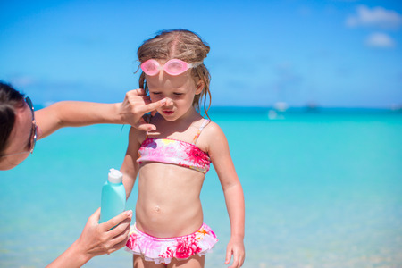 child protection: Child protection sun cream on the beach