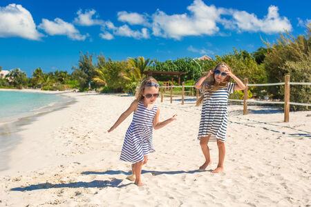Little cute girls enjoy their summer vacation on beach Stock Photo - 28410182