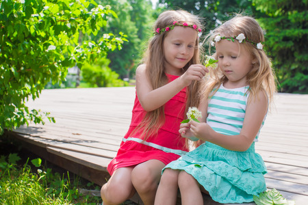 Portrait of adorable little girls on a warm summer day Stock Photo