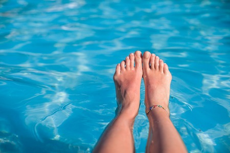 Close up of a womans foot in the water photo