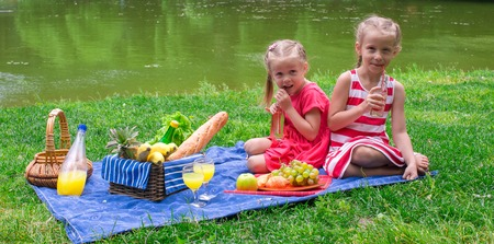 Two little girls on picnic in the park photo