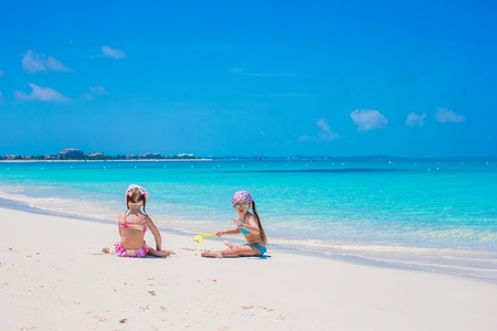 Little cute girls on white beach during vacation Stock Photo - 30121709