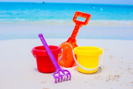 Summer kid s beach toys in the white sand photo