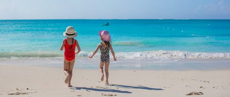 Back view of two sisters looking at the sea on the white beach Stock Photo - 30094405