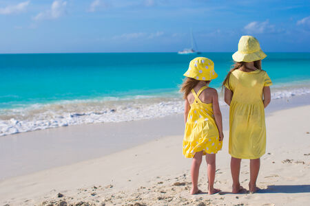 Back view of two little girls on caribbean vacation Stock Photo - 30122842