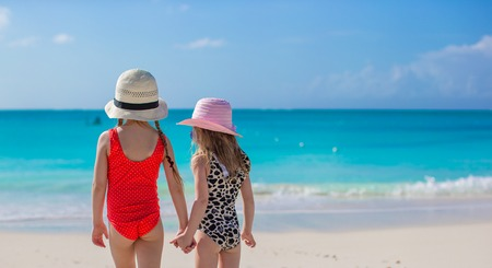 Back view of two sisters looking at the sea on the white beach Stock Photo - 30094388