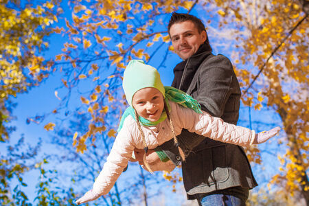 Little cute girl with happy father having fun on sunny day photo
