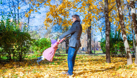 september 2: Young father and little girl enjoy vacation in autumn park
