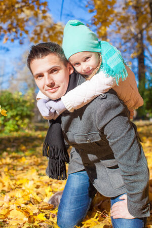 Family of two having fun in autumn park on sunny day photo
