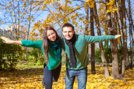 september 2: Young couple in autumn park on a sunny fall day