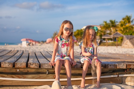 youngbaby: Two happy little girls enjoy vacation on white beach