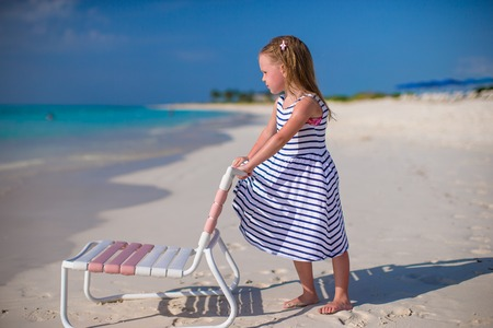 youngbaby: Little adorable girl in beach chair during caribbean vacation Stock Photo