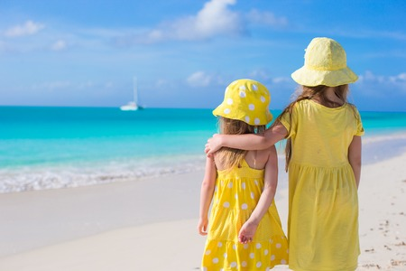 Back view of two little girls on caribbean vacation Stock Photo - 30818737