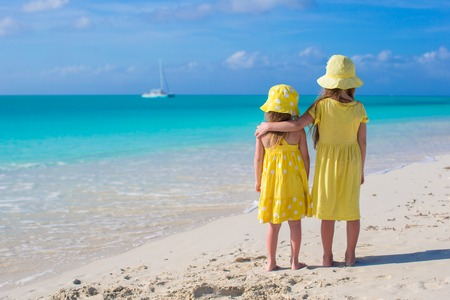 Back view of two little girls on caribbean vacation Stock Photo - 30818745