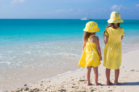 Back view of two little girls on caribbean vacation Stock Photo - 30819042