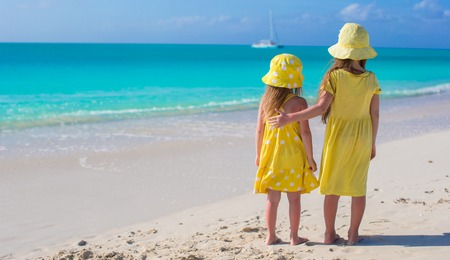 Back view of two little girls on caribbean vacation Stock Photo - 30819087
