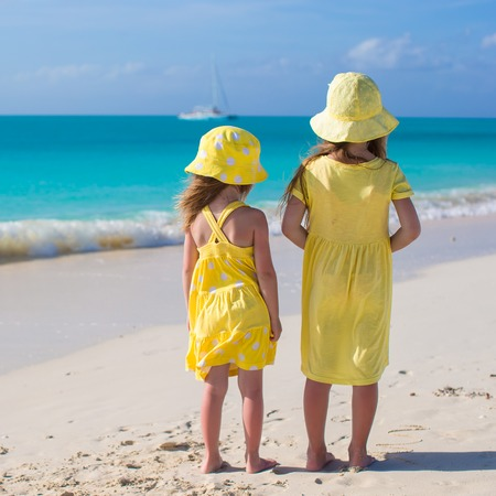 Back view of two little girls on caribbean vacation Stock Photo - 30819208