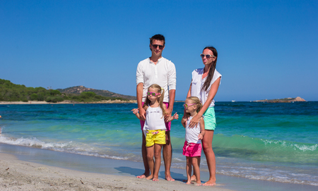 Family of four on beach vacation in Italy photo