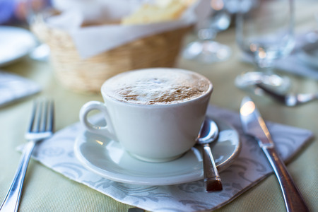 Delicious and tasty cappuccino for breakfast at a cafe in the resort photo