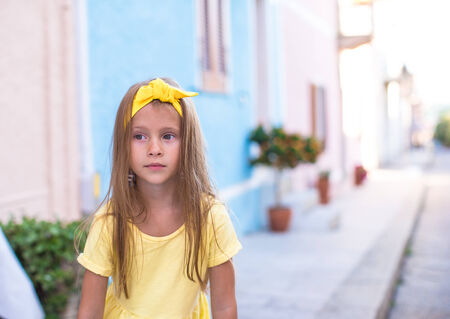 Adorable little girl outdoors during summer vacation photo