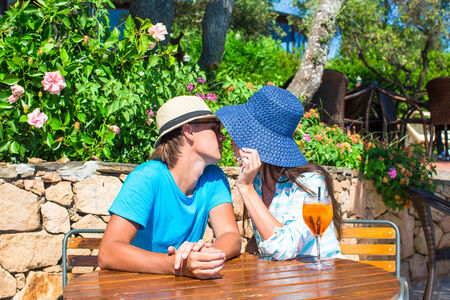 Young couple relaxing in outdoor cafe photo